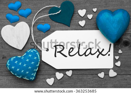 Black And White Label With Blue Hearts, Text Relax - stock photo