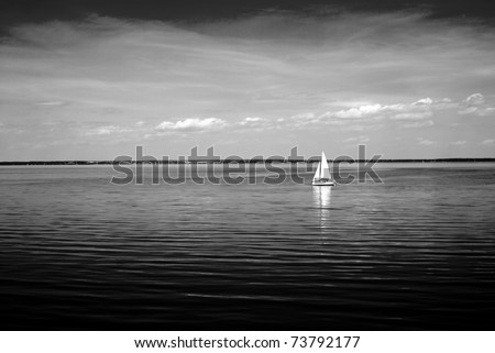 Black and white landscape from a lake with boats - stock photo