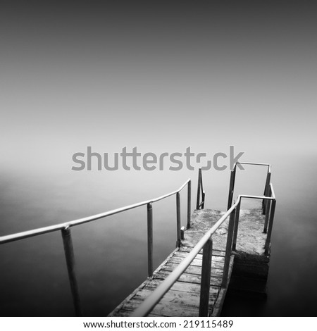 Black and white long exposure minimalistic shot of old steps to the sea. Odessa, Ukraine - stock photo