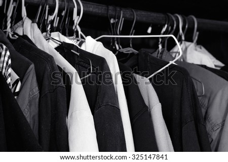 Black and White lot of t-shirt on a hanger / T-shirt on a hanger