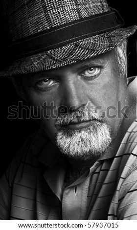 Black and white low light portrait of a middle aged man - stock photo
