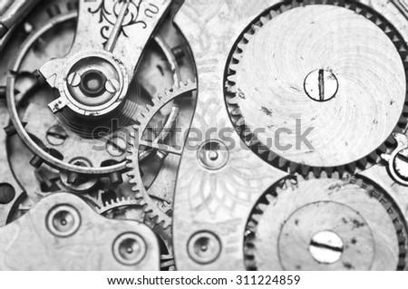 Black and white macro photo close-up view of metal clockwork. Concept eternity, teamwork - stock photo