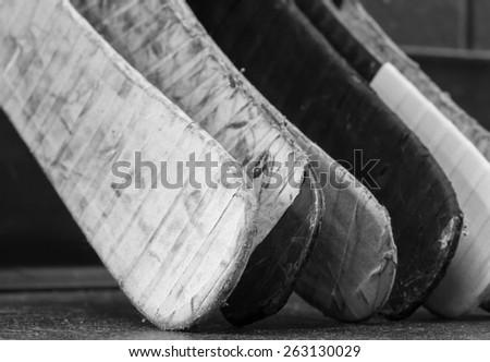 Black and white macro shot of hockey stick blades - Shallow depth of field - stock photo