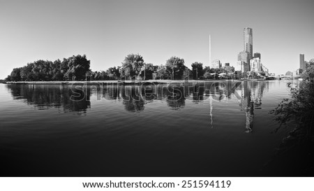 black and white melbourne reflected in the yarra river - stock photo
