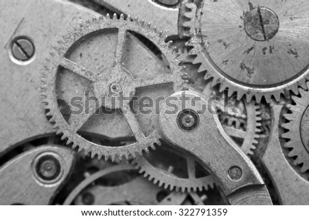 Black and white Metal Cogwheels in Oldest Rusty Clockwork, Macro. Concept Teamwork, Idea Technology