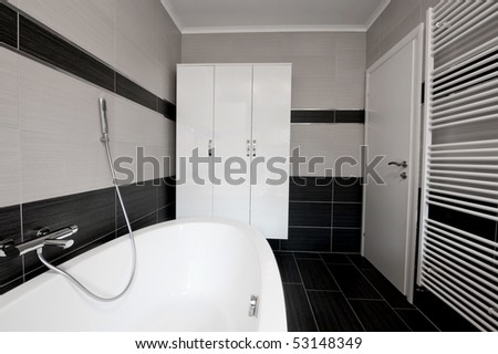 Black and white modern bathroom - stock photo