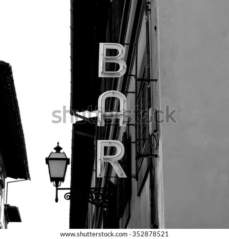 Black and White Neon Lights spelling BAR in the street - stock photo