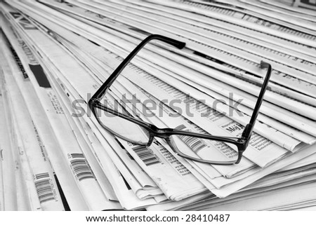 Black and white newspaper and glasses - stock photo