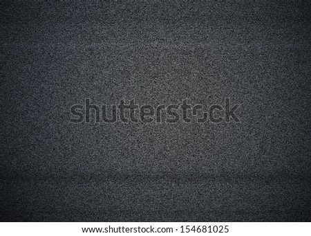 Black and white noise on a TV screen with no signal, also called TV snow. - stock photo