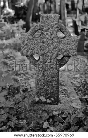 black and white of a close up of tombstones - stock photo
