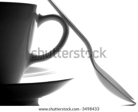 Black and white of a cup,a saucer and a spoon.