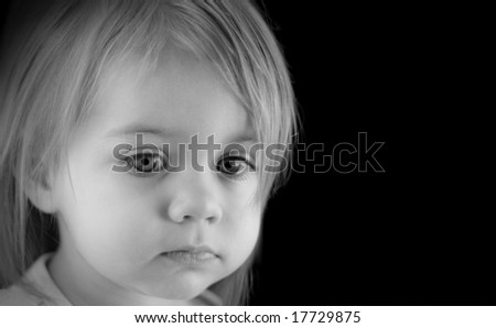 Black and White of a Young Girl with Blonde Hair - stock photo