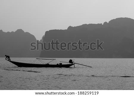 Black and white of boat on Rachapapha dam. Khao Sok National Park. Thailand. - stock photo
