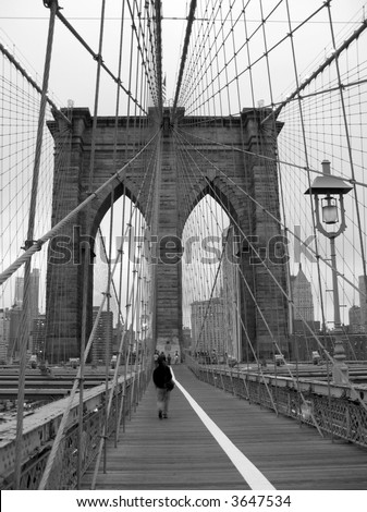 Black and white of Brooklyn Bridge walkway.
