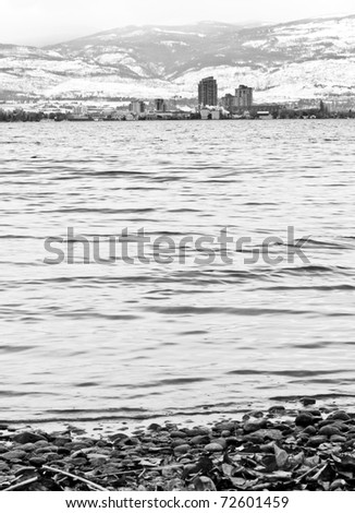 Black and White of City of Kelowna on Other Side of Lake Okanagan - stock photo