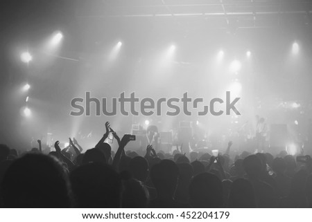 Black and White of Music concert crowds illuminated from stage lights (very shallow depth of field)