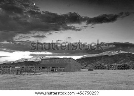 Black and white old barn in Heber Valley, Utah, USA. - stock photo