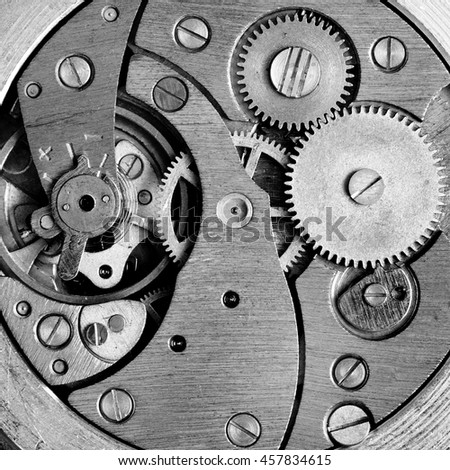 Black and white old clockwork with gears - stock photo
