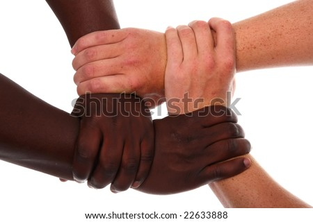 Black and white or caucasian hands clasped together - stock photo