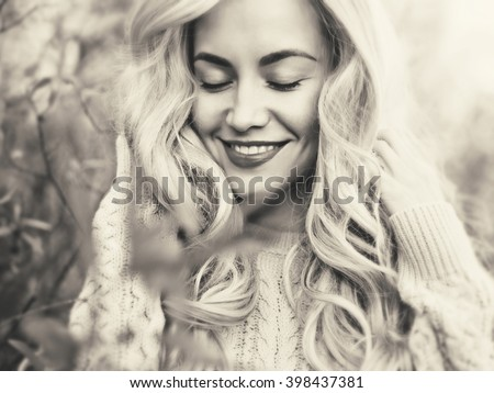 Black and white outdoor fashion photo of young beautiful lady - stock photo