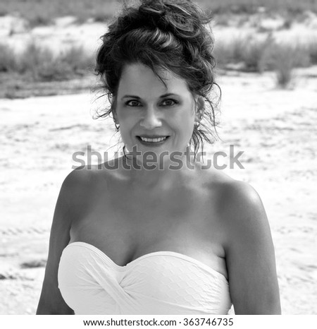 Black and White Outdoor Portrait of a Beautiful Mature Woman on the beach.    - stock photo