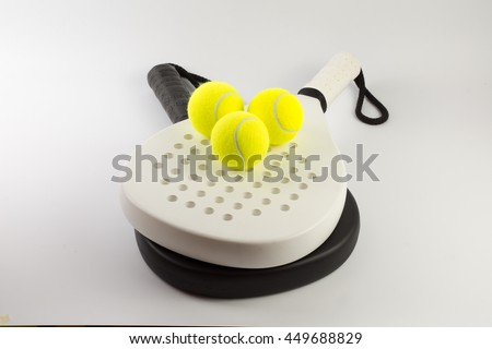 Black and white padel racket with balls - stock photo