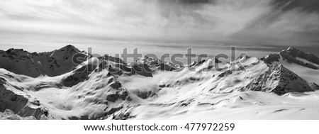 Black and white panorama Caucasus Mountains in snow winter. Elbrus Region. View from Elbrus.
