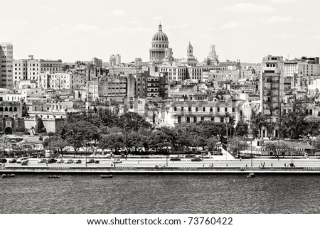 Black and white panorama of Old Havana with some famous buildings including the Capitol and the bay - stock photo