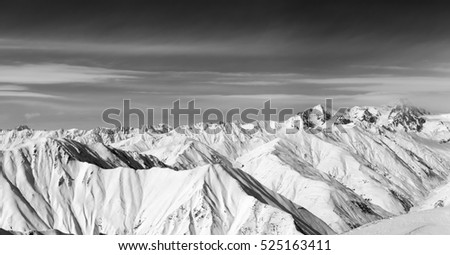 Black and white panorama of snow winter mountains. Caucasus Mountains, Georgia, region Gudauri.