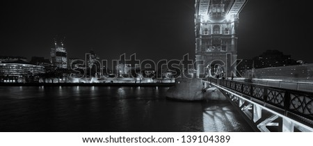 Black and white panorama of Tower bridge and tower prison in London, capital of the UK, at night - stock photo