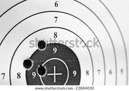 black and white paper target for practice with three holes - stock photo