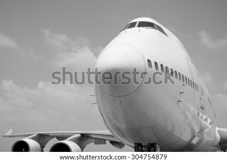 black and white Passenger planes at the airport shoot on the bus - stock photo