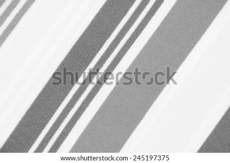 Black and white patterned fabric surface. - stock photo