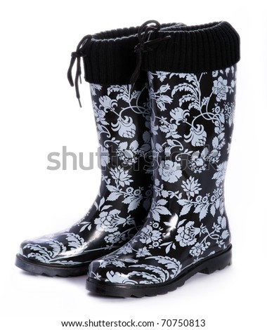 Black and white patterned rainboots - stock photo