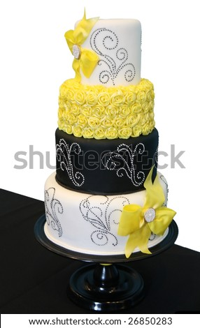 Black and White Patterned Wedding Cake with Yellow Roses - stock photo