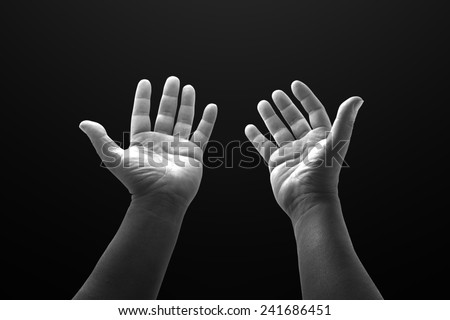 Black and white people open empty hands with palms up. - stock photo