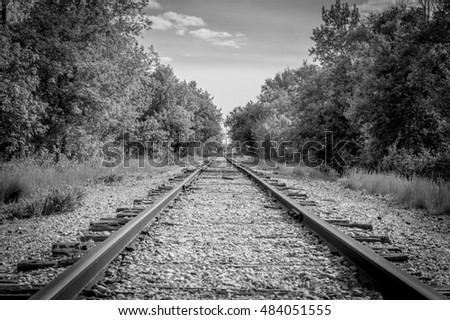 Black and white perspective train tracks