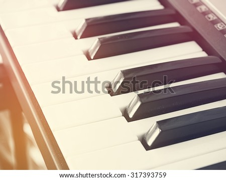 Black and white photo and lighting of the piano keys. : Vintage or retro style and filtered process.  - stock photo