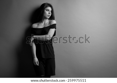 black and white photo. Beautiful caucasian brunette woman with long shiny brown hair and clean skin. Portrait of a fashion model in studio - stock photo