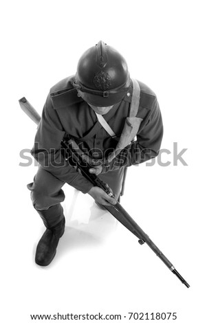 Black and white photo detail of the uniform of an ordinary and helmet soldier of the Russian army during the First World War, on a white background in the studio