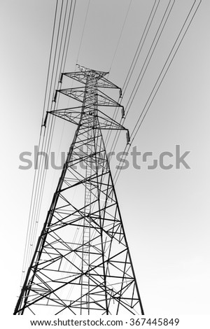 black and white photo effect of High voltage electricity pole with wire