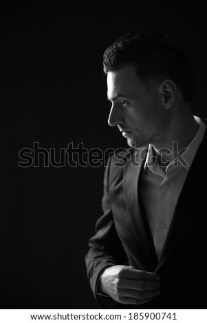 Black and white photo of a pensive businessman looking away - stock photo