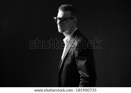 Black and white photo of a thoughtful businessman in glasses - stock photo