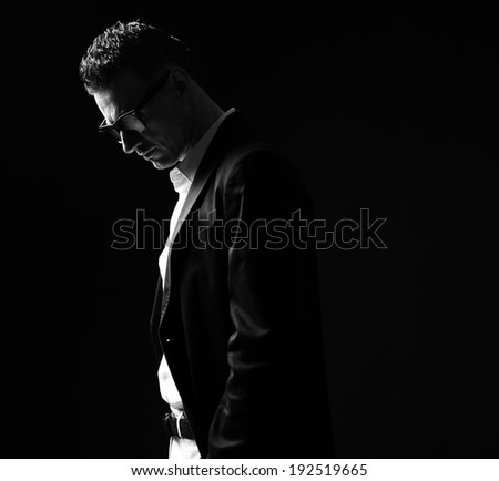Black and white photo of a thoughtful stylish man - stock photo