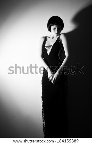 Black and white photo of a woman in the style of 20's - stock photo