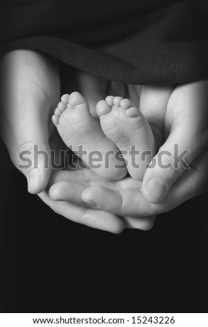 black and white photo of baby feet - stock photo