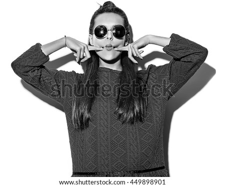 "black and white photo of beautiful crazy brunette woman girl in casual hipster summer clothes isolated on white  in sunglasses making funny ""fish-face"""