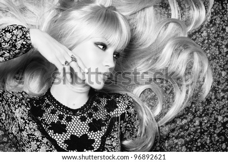 Black and white photo of  beautiful woman with magnificent hair - stock photo