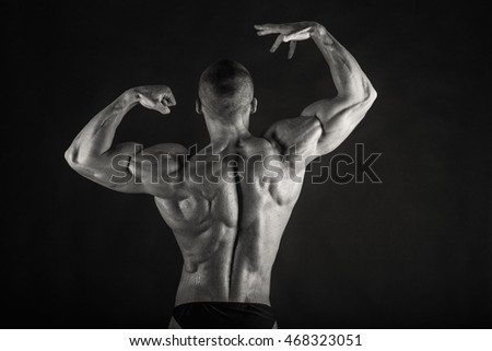 Black and white photo of bodybuilder