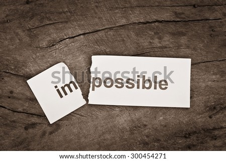 Black and white photo of Changing word impossible transformed to possible. Conceptual of successfully overcoming problems. - stock photo